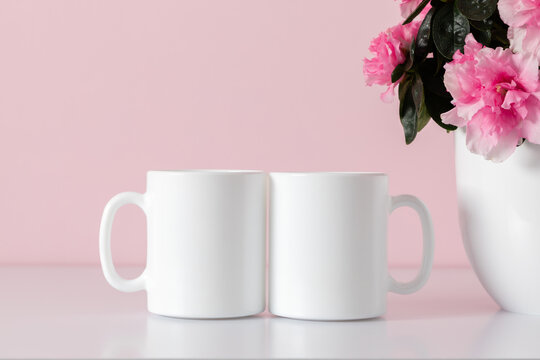 Two mugs mockup, pot with pink flowers on pink background.