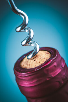 Wine bottle and wine opener on blue