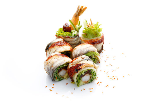 6 piece sushi set with eel, shrimp in tempura, cucumber, on a white background, with sesame seeds. Unagi ebi ten roll, isolated on white, with a copy-space. A packshot photo.