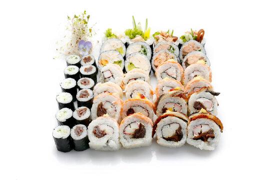 Big sushi set. 36 piece: futomaki, hosomaki, dragon roll, with salmon, crab sticks, pickled radish, kanpyo gourd, cucumber, isolated on white background. Packshot photo for sushi restaurant menu.