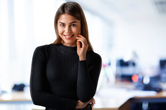 Portrait of smiling young businesswoman standing at the office