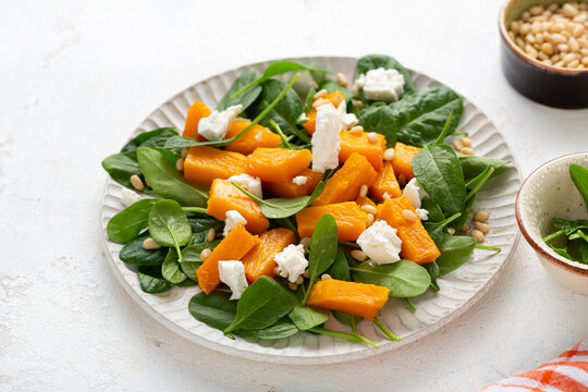 Close up of Roasted pumpkin salad with greens food