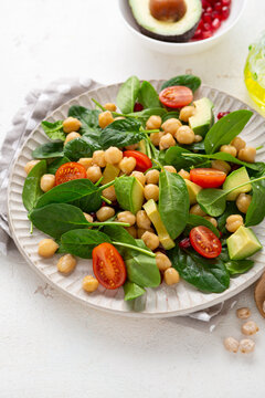 Close up of vegan slad with avocado chickpea and spinach