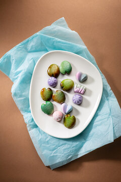 Sweet candies for gift chococlate bonbons on wrapping paper