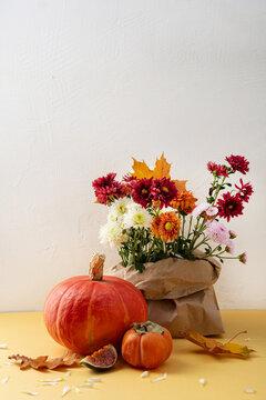 Autumn holiday harvest concept pumpkin fruits flowers
