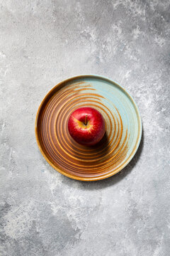 One Red apple on plate autumn pie concept food top view