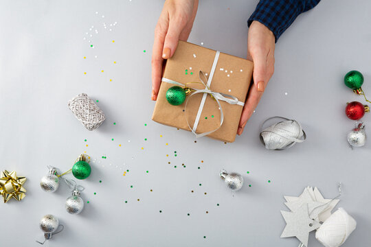 Overhead view of Christmas gift concept with hand and decorations
