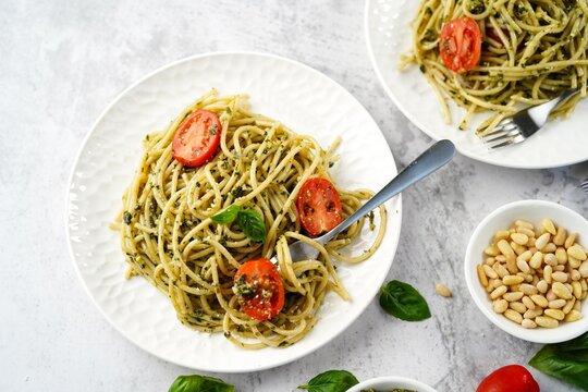 Homemade Pesto pasta with spaghetti cherry tomatoes and parmesan cheese