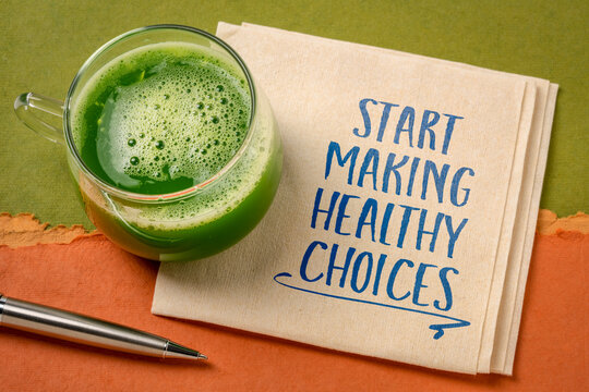 start making healthy choices motivational reminder - handwriting on a napkin with a green vegetable juice, lifestyle and personal development concept