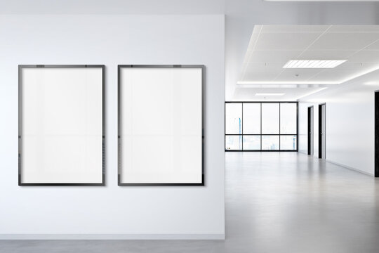 Two vertical frames Mockup hanging on wall. Mock up of billboards in modern concrete office interior 3D rendering