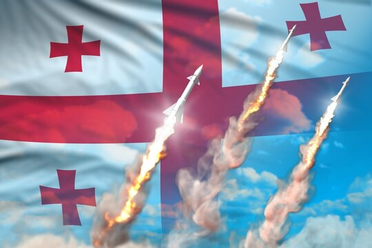 Georgia supersonic warhead launch - modern strategic nuclear rocket weapons concept on blue sky background, military industrial 3D illustration with flag