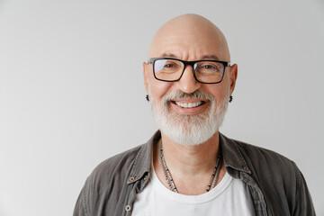 Fototapeta Bald european man in eyeglasses laughing and looking at camera obraz