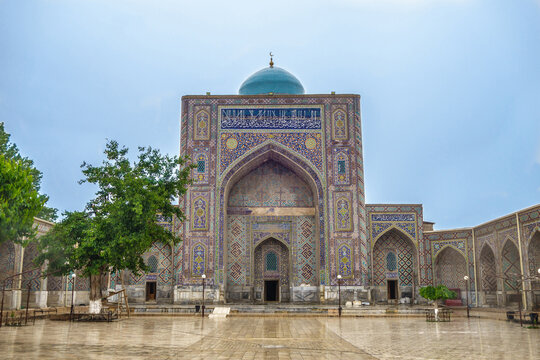 Facade of Nadir Divan-Begi Madrasah in Samarkand, Uzbekistan. Building is richly decorated with traditional ornaments and patterns