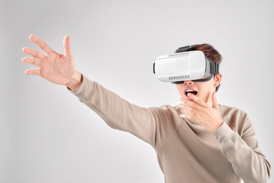 Happy man getting experience using VR headset glasses of virtual reality,