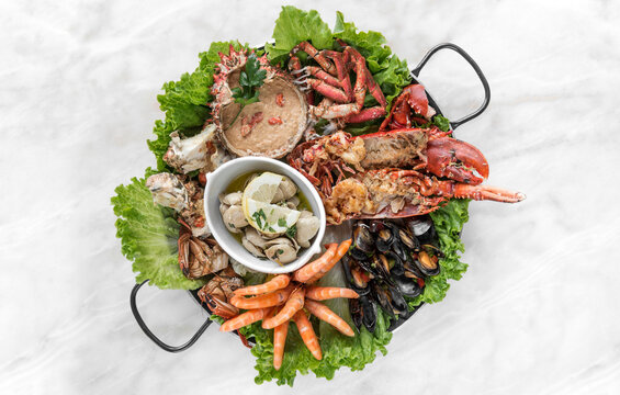 mixed fresh seafood gourmet platter on spanish restaurant table