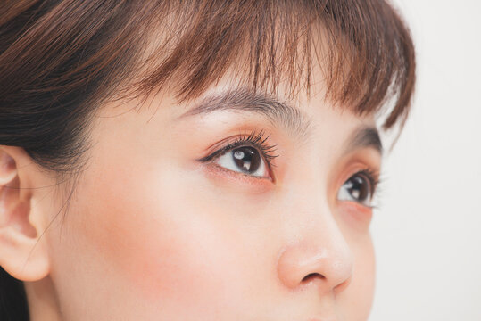 Closeup shot of asian woman brown eye with day makeup