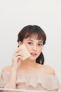Pretty girl remove gloss. Face skin care. Woman using blotting papers