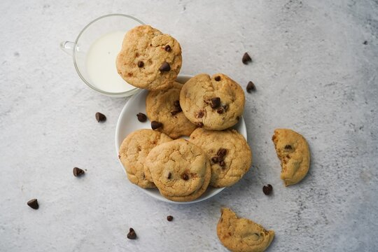 Homemade chocolate chip cookies served with milk, selective focus