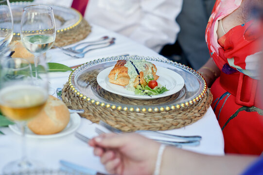 Delicious dish on plate on banquet