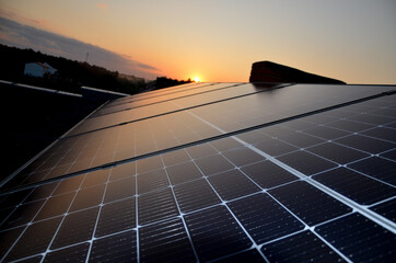 sunset in the solar panels