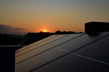 Fototapeta sunset in solar panels obraz