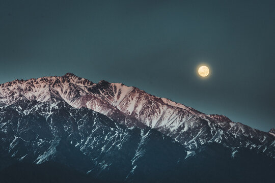 full moon view over mountains