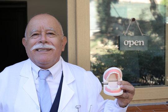 Senior bald dentist with a mustache