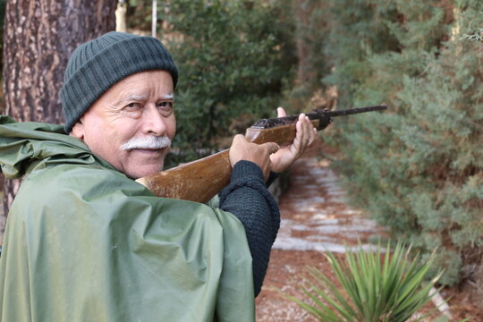 Senior hunter with a mustache in the forest