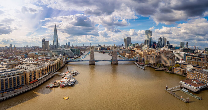 Elevated view of the modern skyline of London, United Kingdom, with Tower Bridge and the modern office skyscrapers along the Thames river during a sunny day