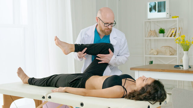The Physical Therapist Evaluates the Condition and Suggests Appropriate Treatment to Relieve the Patient's Pain. Physiotherapy Treatment in the Modern Rehabilitation Clinic