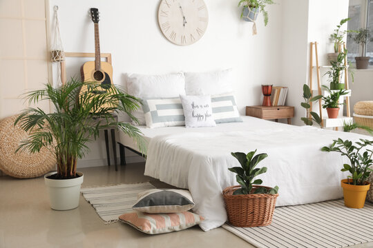 Interior of stylish bedroom with plants