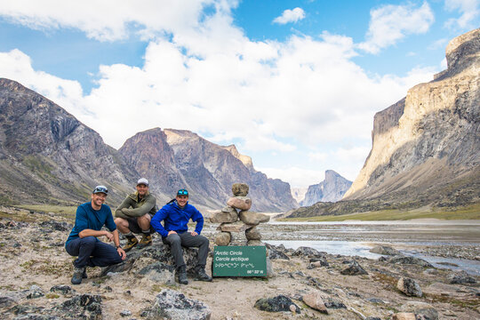 Three mountaineers pose for picture at the Arctic Circle Akshayuk Pass