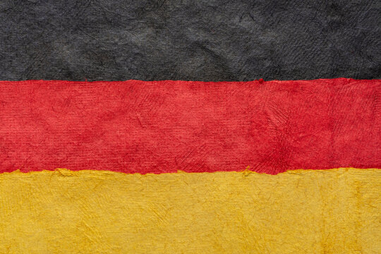 paper abstract in colors of Germany national flag - black, red and gold, set of textured, handmade, bark paper sheets