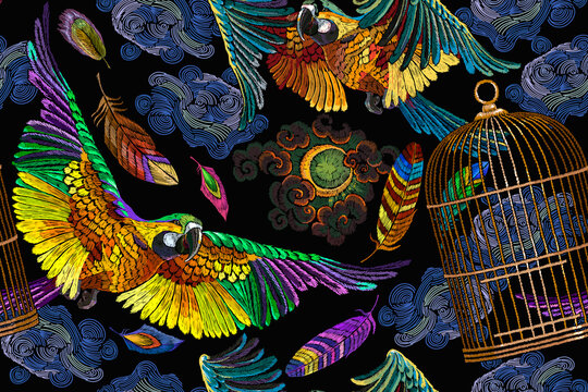 Colorful flying ara parrots, moon and golden cage. Horizontal seamless pattern. Fashionable template for design of clothes, textiles. Macaws. Brazilian birds. Jungle paradise background