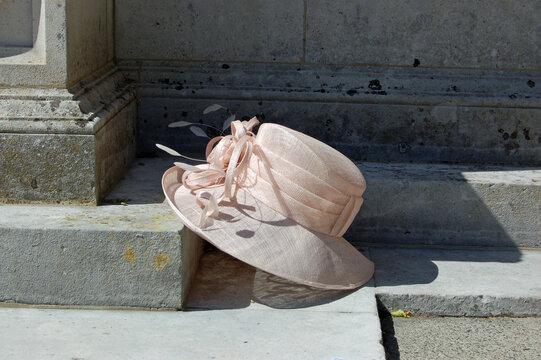Lady's hat resting on church step, wedding still life