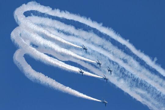 Japan Air Self-Defense Force(JASDF) acrobat team Blue Impulse performed loops and rolls maneuvers at Iruma Air Base.