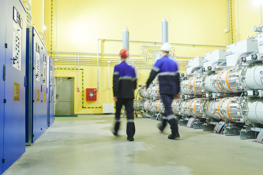industrial technicians walks at power energy supply factory