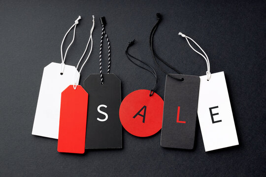 Six different price tags on black background with SALE inscription.