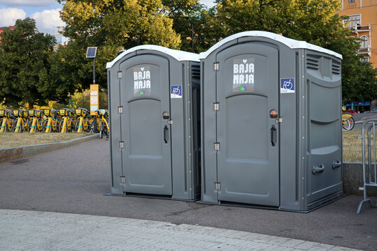 Two Bajamaja portable toilets, accessible, with wheelchair or handicapped access.