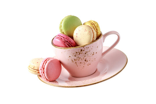 French sweet colorful cookies macarons macaroons in vintage pink cup flying isolated  on white background.