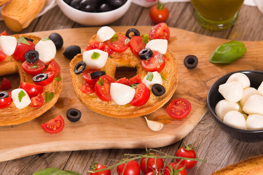 Friselle with tomatoes and mozzarella cheese.