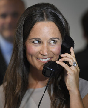 Britain's Middleton speaks on a telephone as dealers work on a trading floor during a charity day at BGC Partners in the Canary Wharf business district in London, Britain