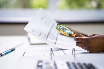 Lawyer Examining Paper Using Magnifier Glass