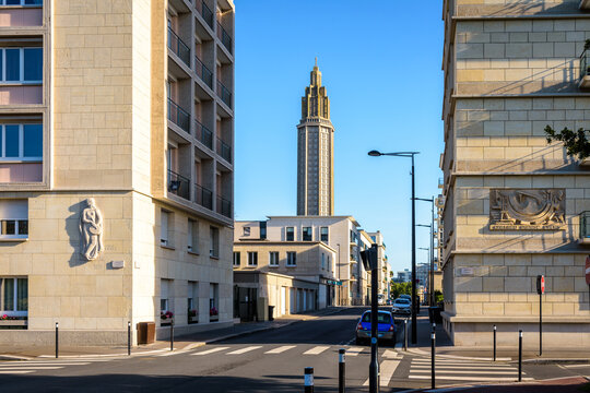 Le Havre, France - June 7, 2021: St Joseph church, its lantern tower and the two buildings in the foreground are the work of Auguste Perret in charge of rebuilding the city center razed during WWII.