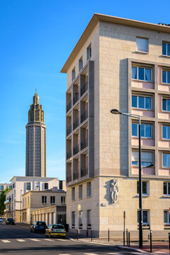 Le Havre, France - June 7, 2021: St Joseph church, its lantern tower and the building in the foreground are the work of Auguste Perret in charge of rebuilding the city center destroyed during WWII.
