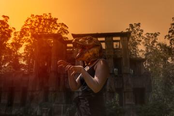 Obraz Woman in dinosaur mask gesturing with hands terror halloween concept - fototapety do salonu