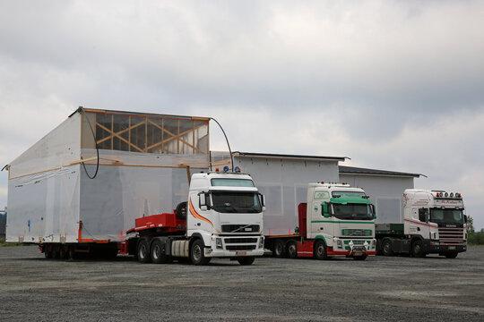 Three Oversize Load Transport Trucks