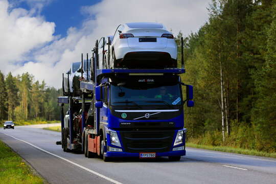 Blue Volvo FM Car Transporter Hauls New Cars