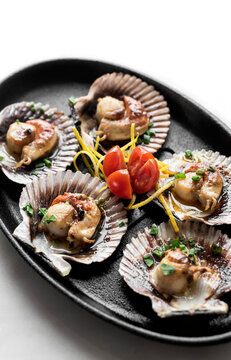 scallops in shell seafood tapas portion in barcelona restaurant spain