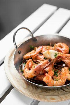 sauteed stir fry large prawns spanish tapas in metal pot